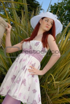 Cute young lady in summer dress