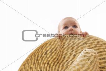little baby hidden behind a big hat, portrait