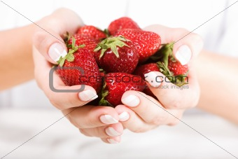 Beautiful hand with fresh strawberry