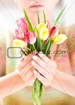 Beautiful hands with bunch of tulips
