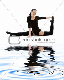 fitness instructor in black leotard on white sand #2