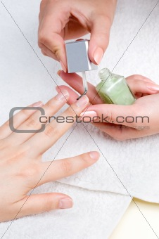 applying manicure, moisturizing the nails