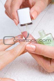 applying manicure, moisturizing the nails