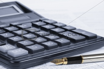 Calculator, pen, papers