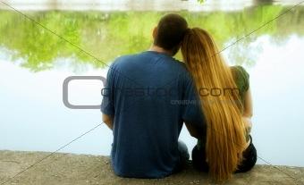 Couple sitting on lakeside
