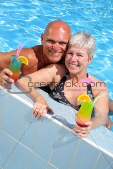beautiful couple relaxing by the pool