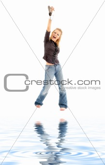 screaming blond with shoe on white sand