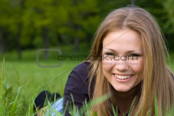 cute girl lying at meadow