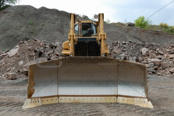 Huge bulldozer in a stone pit