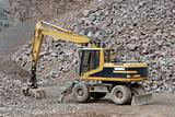 Excavator in a stone pit