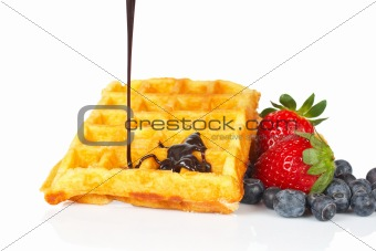 Poured syrup on waffles