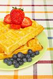 Waffles, blueberries and strawberries
