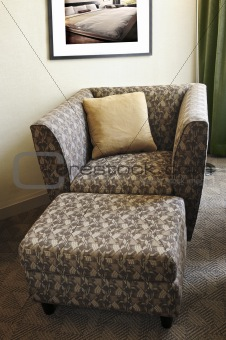 Armchair with ottoman