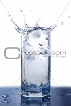 Splashing ice cubes in the glass