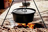 Traditional Dutch Oven Cooking Over Flame