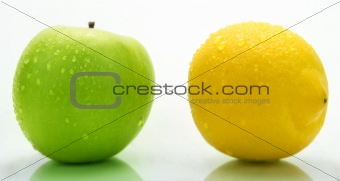Green apple and lemon with water drops