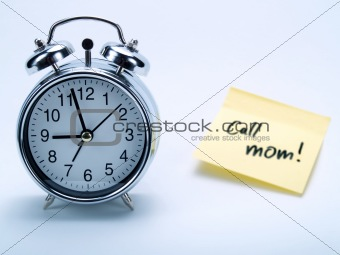 Alarm clock and yellow note