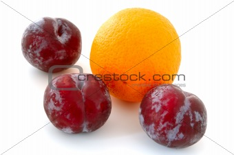 Plums and orange.