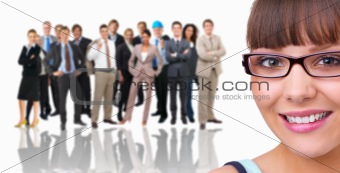 Portrait of a businesswoman in front of a crowd of people