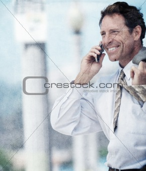 Smiling business man talking on phone with added grunge