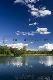 Fisherman in boat. River Drava, Croatia