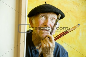 Artist with a Beret at a Canvas looking up