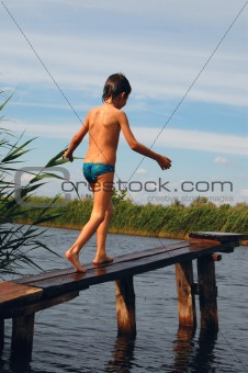 boy going along the pier