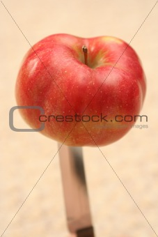 Apple on a knife