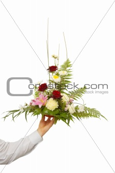 beautiful bouquet held by man's left hand. isolated on white.