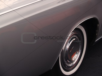 Auto Classics: 1968 Vintage Silver Car; fender side-view  with copy space