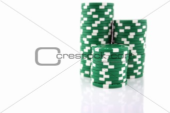 3 part stacks of green casino chips