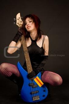 Beautiful girl with bass guitar