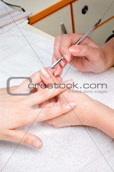 applying manicure - cuticle cleaning