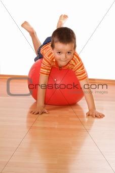 Little boy making gym