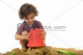 boy playing in the sand