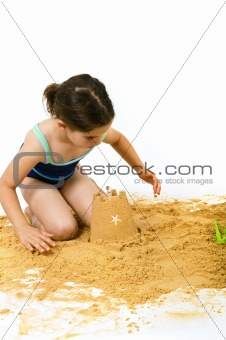 girl playing in the sand
