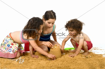 three kids playing in the sand