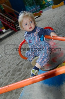 baby on merry-go-round