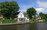 Dutch houses, boat, canal and trees