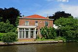 Dutch house, canal and trees