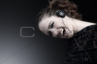 Woman with long curly hair enjoying nusic