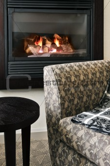 Fireplace and armchair