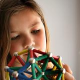 Young girl and geometric shape