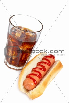 A hot dog and soda glass