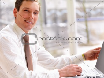 Successful handsome business man working on his computer