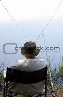 An old man enjoys fishing