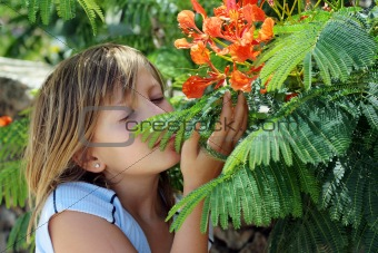 Little girl and  colorful flowers