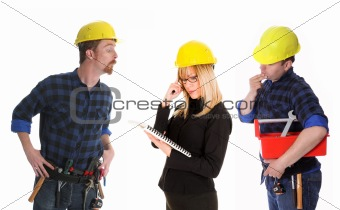 angry businesswoman and construction workers