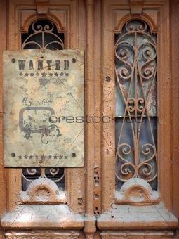 Old door with the broken glasses