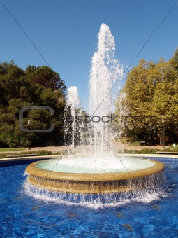 Fountain spraying up with pool of water